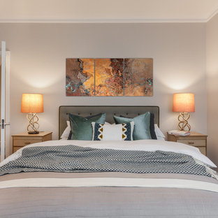 This is an example of a large traditional master bedroom in London with grey walls, carpet, no fireplace and grey floors.