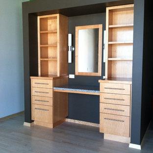 Mid-sized light wood floor and brown floor bedroom photo in Albuquerque