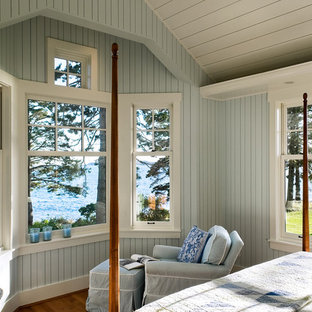 This is an example of a coastal bedroom in Portland Maine with blue walls.