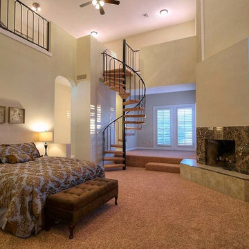 Master Bedroom with spiral stairs to loft