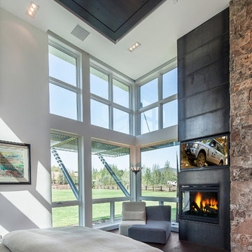 master bedroom with steel & stone fireplace