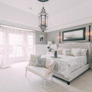 Large shabby-chic style master bedroom in Nashville with grey walls, carpet, white floor and no fireplace.
