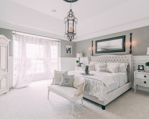 example of a large cottage chic master bedroom design in nashville with gray walls carpet