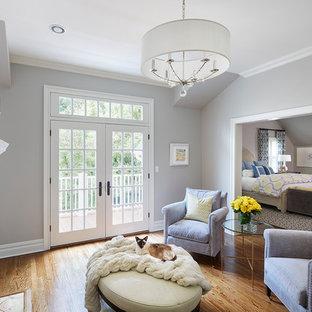 На фото: хозяйские спальни в классическом стиле с синими стенами, паркетным полом среднего тона, стандартным камином и фасадом камина из дерева
