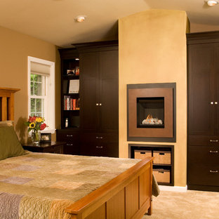 Bedroom - traditional master carpeted bedroom idea in Seattle with brown walls and a standard fireplace