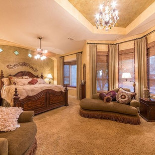 This is an example of a large mediterranean master bedroom in Other with carpet.