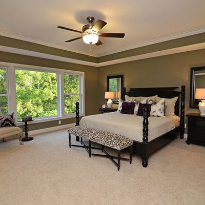 Elegant master carpeted bedroom photo in Minneapolis with gray walls