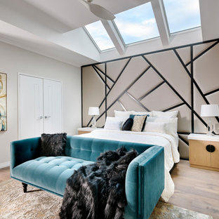 Inspiration for an expansive contemporary master bedroom in Perth with grey walls, medium hardwood floors, no fireplace and brown floor.