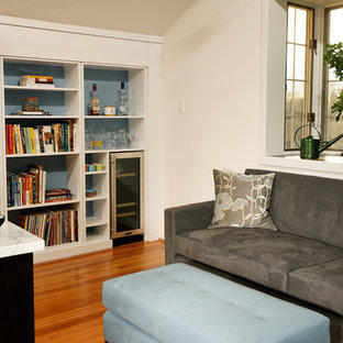 Small transitional loft-style bedroom in DC Metro with medium hardwood floors, brown walls and a ribbon fireplace.