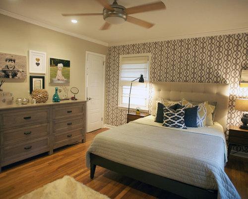 contemporary bedroom idea in atlanta with beige walls and medium tone hardwood floors