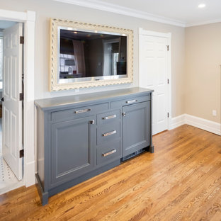Example of a large transitional master light wood floor bedroom design in Philadelphia with beige walls