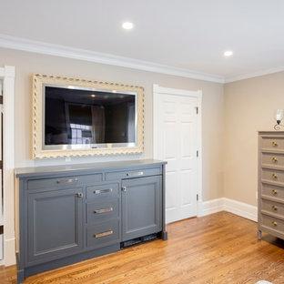 Inspiration for a large transitional master light wood floor bedroom remodel in Philadelphia with beige walls