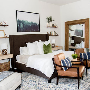 Example of a mid-sized eclectic master laminate floor and brown floor bedroom design in Phoenix with white walls