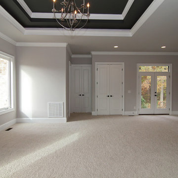 Master suite with French doors to backyard