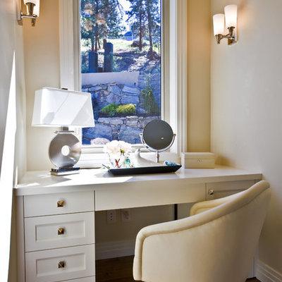 Bedroom - contemporary dark wood floor bedroom idea in Vancouver with beige walls