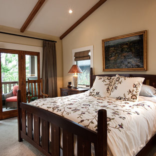 Mid-sized arts and crafts master bedroom in San Diego with beige walls, carpet, no fireplace and beige floor.