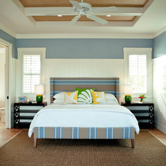 tropical bedroom by Heffel Balagno Design Consultants
