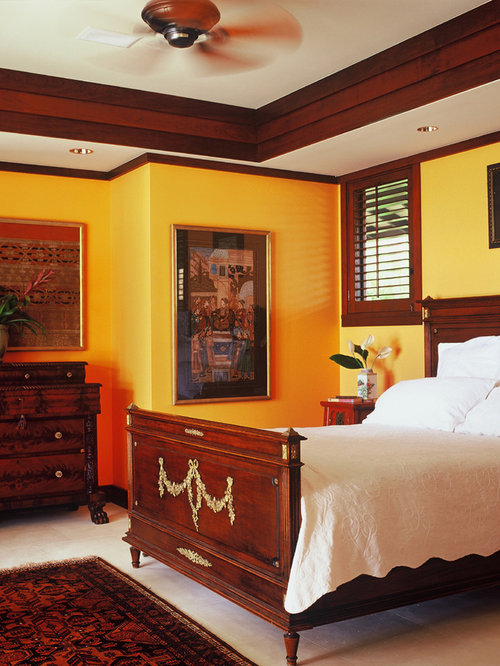 Example Of An Island Style Bedroom Design In Hawaii With Yellow Walls