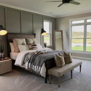 Example of a transitional carpeted and beige floor bedroom design in Other with gray walls