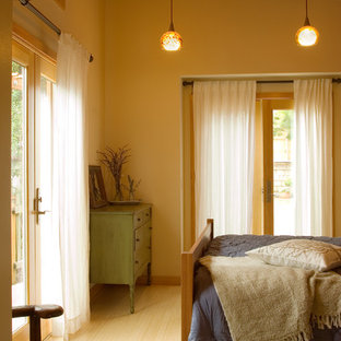 Inspiration for a mid-sized eclectic master bamboo floor bedroom remodel in San Francisco with beige walls