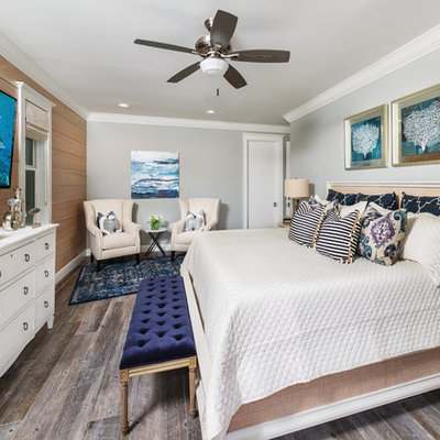Transitional master dark wood floor bedroom photo in Miami with gray walls