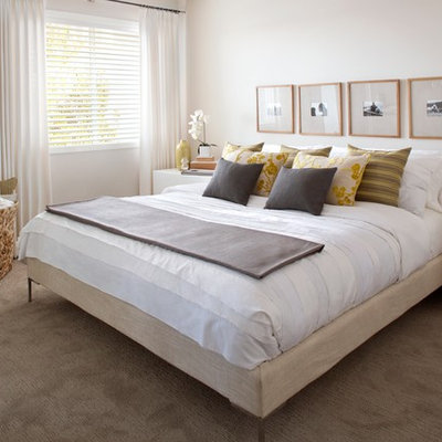 Trendy carpeted bedroom photo in Calgary with beige walls