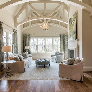 На фото: огромная спальня в стиле современная классика с бежевыми стенами, паркетным полом среднего тона, стандартным камином, фасадом камина из камня и коричневым полом с