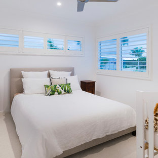 Photo of a small beach style guest bedroom in Gold Coast - Tweed with white walls, carpet and beige floor.