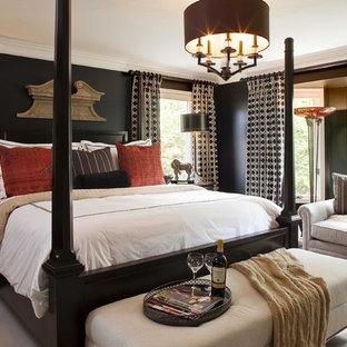 Example of a classic medium tone wood floor bedroom design in Kansas City with black walls