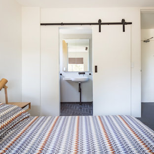 Example of a small minimalist master linoleum floor and blue floor bedroom design in Sydney with white walls