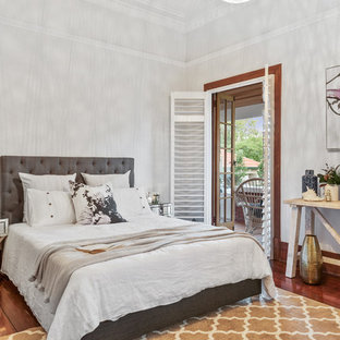 Design ideas for a traditional guest bedroom in Perth with grey walls and dark hardwood floors.