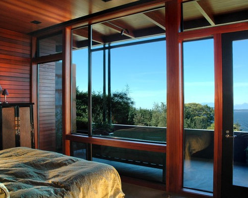 inspiration for an industrial bedroom remodel in seattle with brown walls - Bedroom Balcony Designs