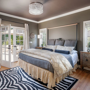 Trendy medium tone wood floor bedroom photo in Seattle with gray walls