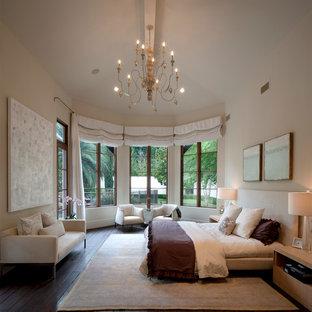 Large tuscan master dark wood floor bedroom photo in Houston with beige walls
