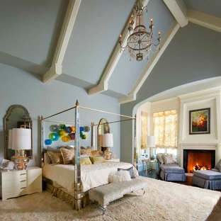 Example of a tuscan bedroom design in Dallas with blue walls