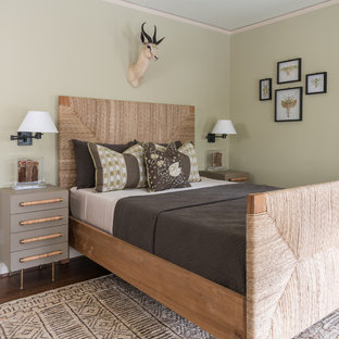 Example of a tuscan dark wood floor and brown floor bedroom design in Dallas with green walls