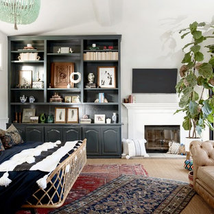 Bedroom - mediterranean carpeted and beige floor bedroom idea in Orange County with white walls and a standard fireplace