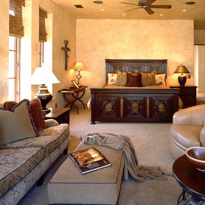 Tuscan master carpeted bedroom photo in Atlanta with beige walls