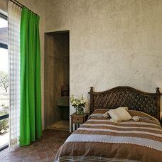 Mediterranean Bedroom by David Howell Design