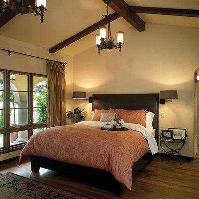 Bedroom - mediterranean dark wood floor bedroom idea in Los Angeles with beige walls