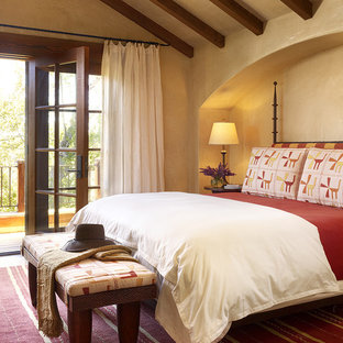 Example Of A Tuscan Bedroom Design In San Francisco With Beige Walls