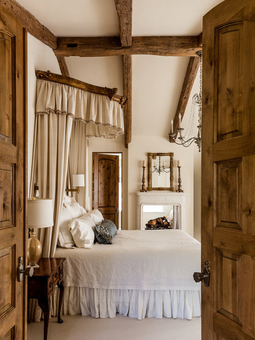 Example Of A Tuscan Carpeted Bedroom Design In Other With Beige Walls
