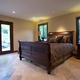 Bedroom - huge traditional master travertine floor and beige floor bedroom idea in Los Angeles with beige walls