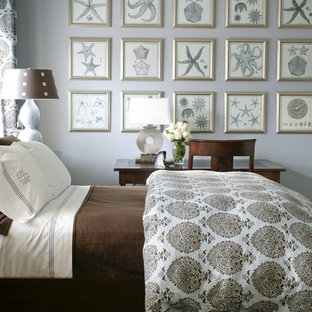 Inspiration for a coastal bedroom remodel in Little Rock with blue walls