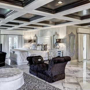 Bedroom - huge traditional master marble floor bedroom idea in Miami with white walls