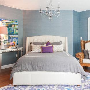 Elegant dark wood floor bedroom photo in Boston with blue walls