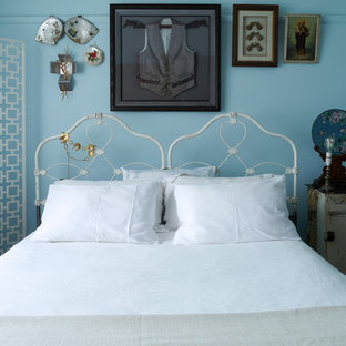 Shabby-chic style bedroom in Melbourne with blue walls.