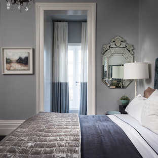 Bedroom - mid-sized transitional master carpeted and black floor bedroom idea in Melbourne with gray walls, a standard fireplace and a wood fireplace surround