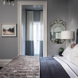 Imagen de dormitorio principal, clásico renovado, de tamaño medio, con paredes grises, moqueta, chimenea tradicional, marco de chimenea de madera y suelo negro