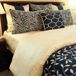 Bedding 2013 - A Masculine Navy and Off White Vine print wtih accents of Stripes, Diamonds, solids and Zebra prints. Pillow are reverisable for a touch a Zebra.